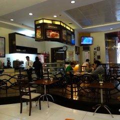 Отель Octagon Mansion Hotel Филиппины, Манила - отзывы, цены и фото номеров - забронировать отель Octagon Mansion Hotel онлайн гостиничный бар
