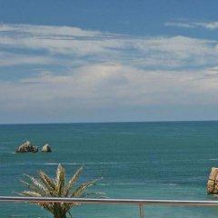 Отель Apartamentos Playa de Portio Испания, Пьелагос - отзывы, цены и фото номеров - забронировать отель Apartamentos Playa de Portio онлайн пляж фото 2