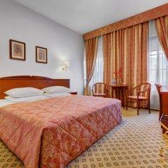 Отель Ассамблея Никитская Москва комната для гостей