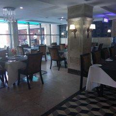 Отель Adig Suites Нигерия, Энугу - отзывы, цены и фото номеров - забронировать отель Adig Suites онлайн питание