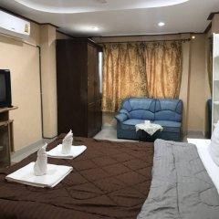 Апартаменты President Apartment Паттайя комната для гостей фото 4