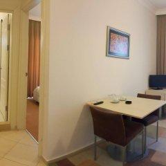 Kamer Suites & Hotel Чешме комната для гостей
