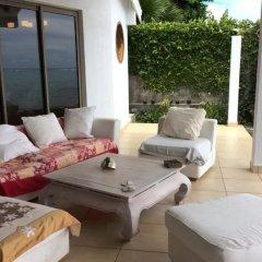 Отель Villa Vahineria 9pax Французская Полинезия, Пунаауиа - отзывы, цены и фото номеров - забронировать отель Villa Vahineria 9pax онлайн балкон
