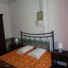 Отель Pensão Aljubarrota Португалия, Лиссабон - 1 отзыв об отеле, цены и фото номеров - забронировать отель Pensão Aljubarrota онлайн комната для гостей фото 4