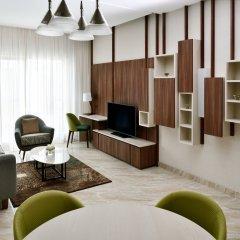 Movenpick Hotel Apartments Downtown Dubai Дубай комната для гостей фото 3