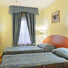 Гостиница Достоевский комната для гостей фото 4