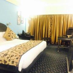 Отель The Suryaa New Delhi комната для гостей фото 2