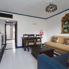 Отель Los Arcos Suites Пуэрто-Вальярта комната для гостей фото 2