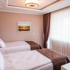 Отель Arpezos Болгария, Карджали - отзывы, цены и фото номеров - забронировать отель Arpezos онлайн комната для гостей фото 4