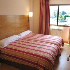 Отель Astuy Apartamentos Арнуэро комната для гостей