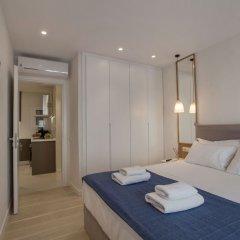 Апартаменты Lovely apartment close to Acropolis by GHH Афины комната для гостей