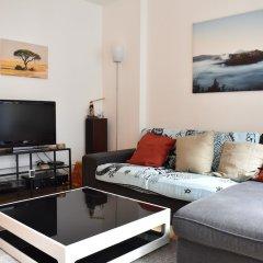 Апартаменты Charming Apartment in Gambetta, Ménilmontant Париж комната для гостей фото 3