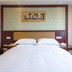 Vienna Hotel Guangzhou Shaheding Metro Station Branch комната для гостей