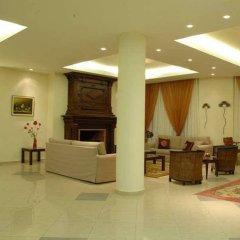 Отель Porfi Beach Hotel Греция, Ситония - 1 отзыв об отеле, цены и фото номеров - забронировать отель Porfi Beach Hotel онлайн интерьер отеля фото 3