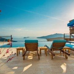 Villa Fusya by Lycia Collections Турция, Калкан - отзывы, цены и фото номеров - забронировать отель Villa Fusya by Lycia Collections онлайн пляж фото 2