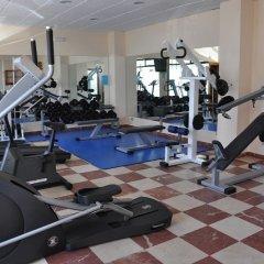 Отель Astuy Apartamentos Арнуэро фитнесс-зал