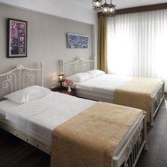 Отель Rüzgargülü Otel Бозджаада комната для гостей фото 5