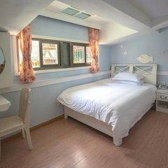 Отель Xiamen Gulangyu Sunshine Dora's House Китай, Сямынь - отзывы, цены и фото номеров - забронировать отель Xiamen Gulangyu Sunshine Dora's House онлайн комната для гостей фото 5