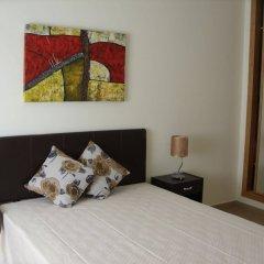 Отель Oasis Parque Country Club Портимао сейф в номере