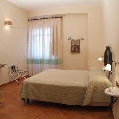 Отель Agriturismo La Casa Di Botro Ботричелло сейф в номере