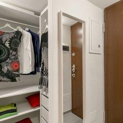 Апартаменты Notami - Green Studio Милан сейф в номере