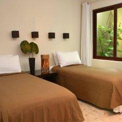 Maya Villa Condo Hotel And Beach Club Плая-дель-Кармен комната для гостей фото 4