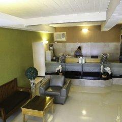 Отель Makati International Inns Филиппины, Макати - 1 отзыв об отеле, цены и фото номеров - забронировать отель Makati International Inns онлайн фитнесс-зал фото 2