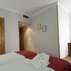 Отель Aparto Suites Muralto сейф в номере