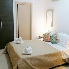 Апартаменты Il Cantone del Faro Apartments Таормина комната для гостей фото 5