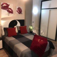 Апартаменты Namaste Apartment Торремолинос комната для гостей