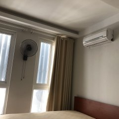 Отель Homestay Des Amis - Ban Huu Хойан сейф в номере