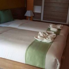 Апартаменты Pintree Service Apartment Pattaya Паттайя комната для гостей фото 5