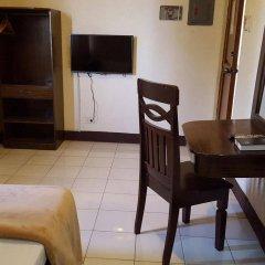 Отель La Chari'ca Inn Филиппины, Пуэрто-Принцеса - отзывы, цены и фото номеров - забронировать отель La Chari'ca Inn онлайн удобства в номере фото 2