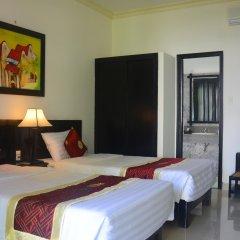 Отель Hoi An Red Frangipani Villa комната для гостей