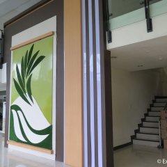 Отель The Ritz Hotel at Garden Oases Филиппины, Давао - отзывы, цены и фото номеров - забронировать отель The Ritz Hotel at Garden Oases онлайн интерьер отеля фото 3