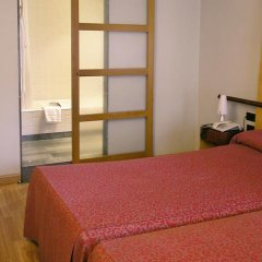 Hotel Sercotel Alfonso V сейф в номере