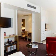 Отель Adina Apartment Hotel Copenhagen Дания, Копенгаген - 1 отзыв об отеле, цены и фото номеров - забронировать отель Adina Apartment Hotel Copenhagen онлайн комната для гостей фото 2