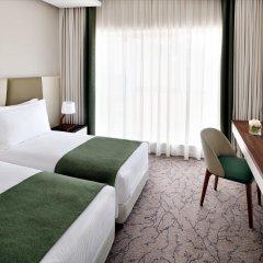 Movenpick Hotel Apartments Downtown Dubai Дубай комната для гостей фото 4