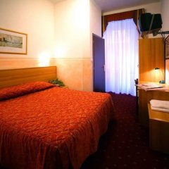 Отель ASSAROTTI Генуя комната для гостей