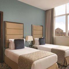 Отель Ramada Corniche Абу-Даби комната для гостей фото 2