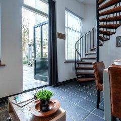 Отель Allure Garden Apartments Нидерланды, Амстердам - отзывы, цены и фото номеров - забронировать отель Allure Garden Apartments онлайн интерьер отеля фото 2