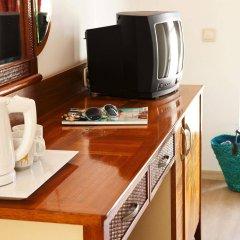 Отель Villa Adora Beach удобства в номере