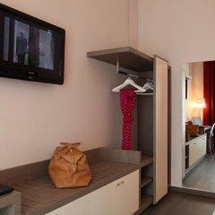 Hotel Tiziano Park & Vita Parcour Gruppo Mini Hotel Милан сейф в номере