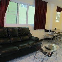 Апартаменты Rouge Service Apartments Паттайя комната для гостей