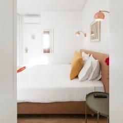 Апартаменты Lisbon Serviced Apartments Chiado Emenda комната для гостей