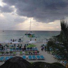 Отель The Gardenia Resort пляж