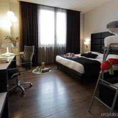Отель Holiday Inn Genoa City Генуя удобства в номере фото 2