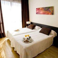 Отель Compostela Suites в номере