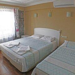 Assos Hotel комната для гостей фото 2