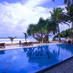 Отель Whispering Palms Hotel Шри-Ланка, Бентота - отзывы, цены и фото номеров - забронировать отель Whispering Palms Hotel онлайн с домашними животными